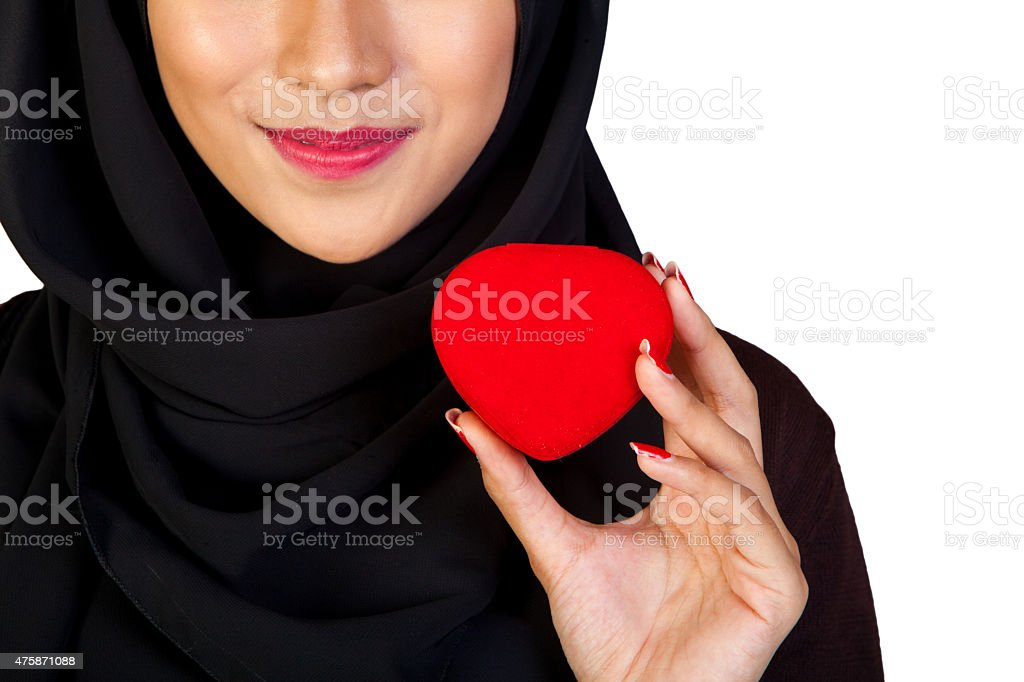 Female Muslim holding heart shape box love symbol stock photo