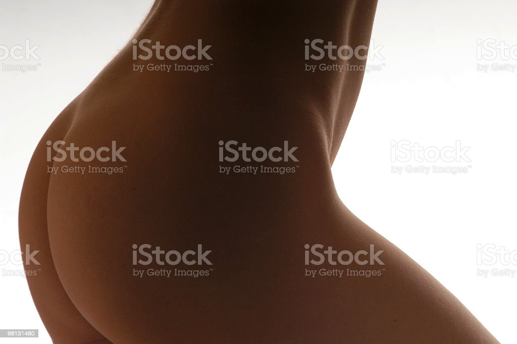 Female naked body, bum, side view, close-up royalty-free stock photo