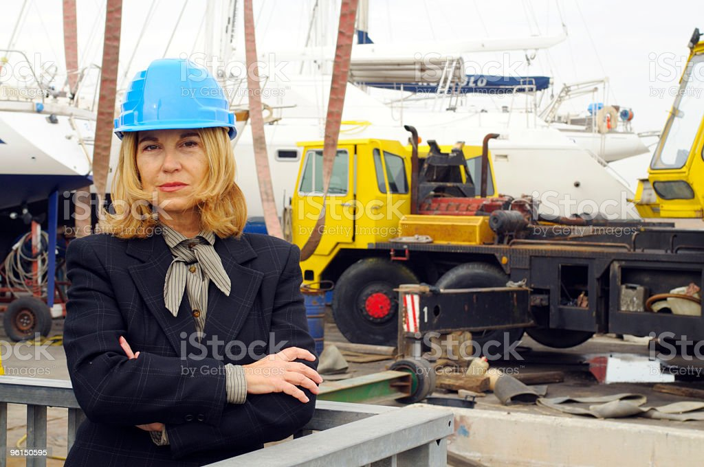 Female naval engineer inside shipyard royalty-free stock photo