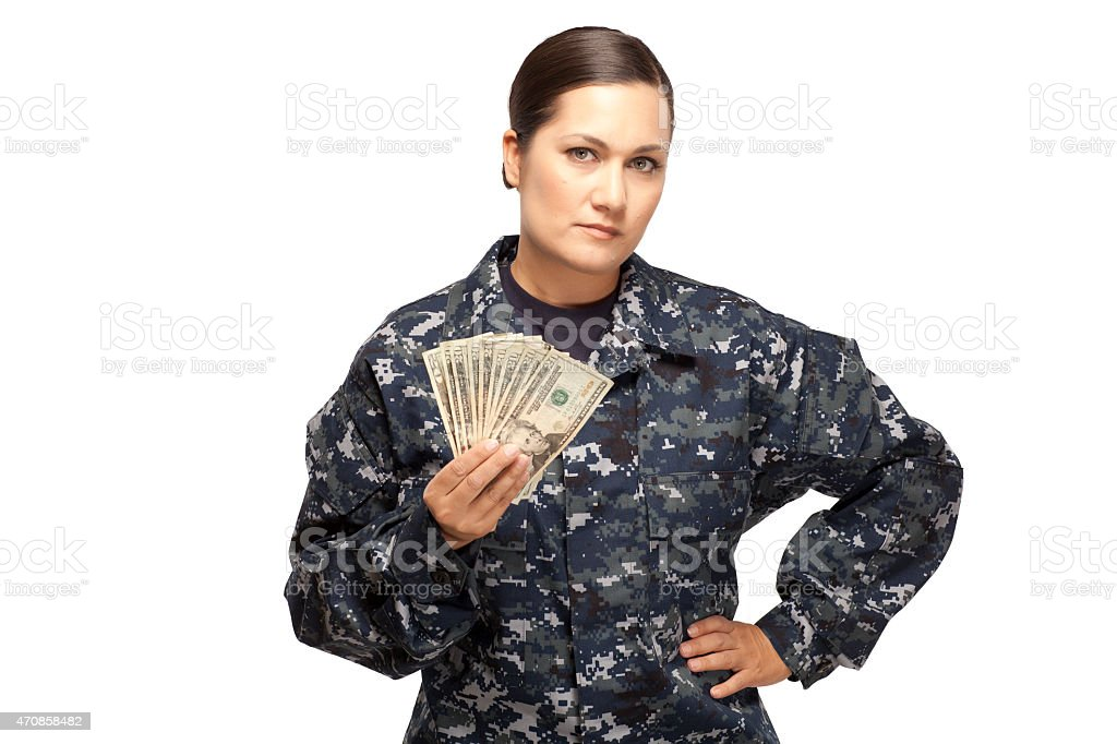 Female navy sailor with money stock photo