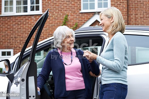 istock Female Neighbor Giving Senior Woman A Lift In Car 624701072