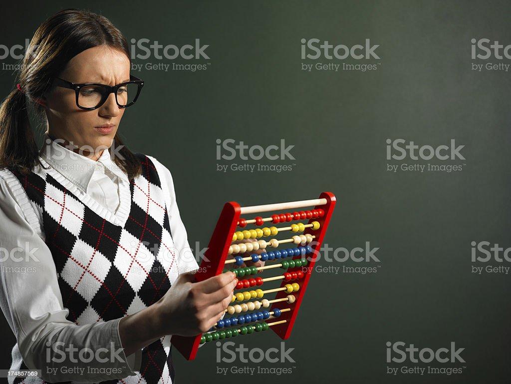 Female nerd holding abacus royalty-free stock photo