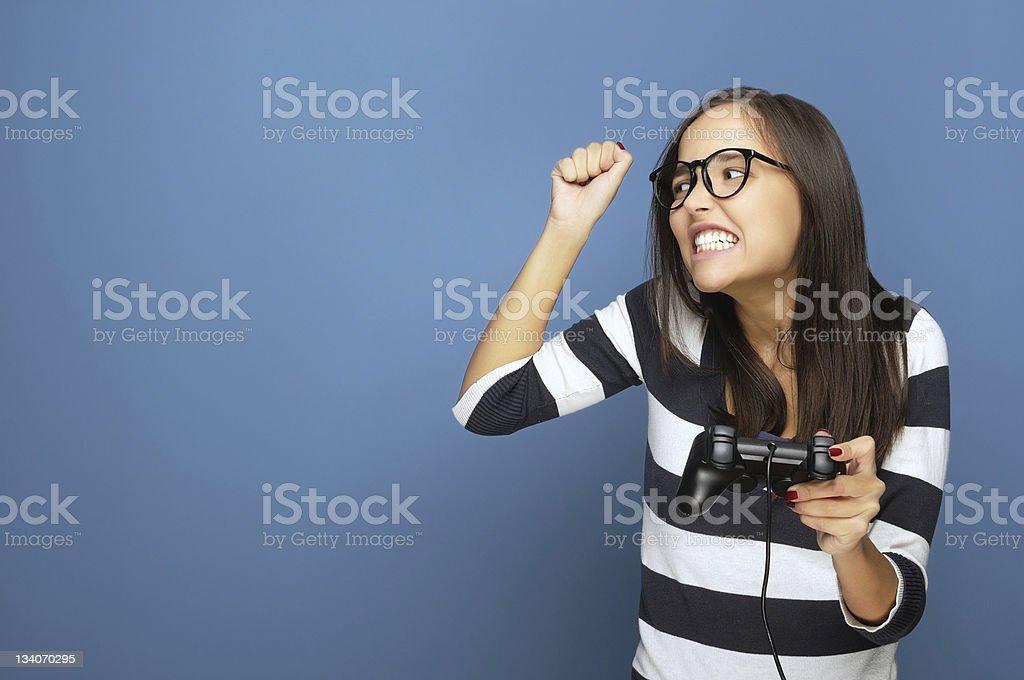 Female nerd with gamepad royalty-free stock photo