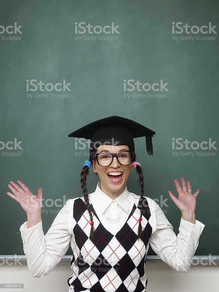 Female nerd with raised arms royalty-free stock photo