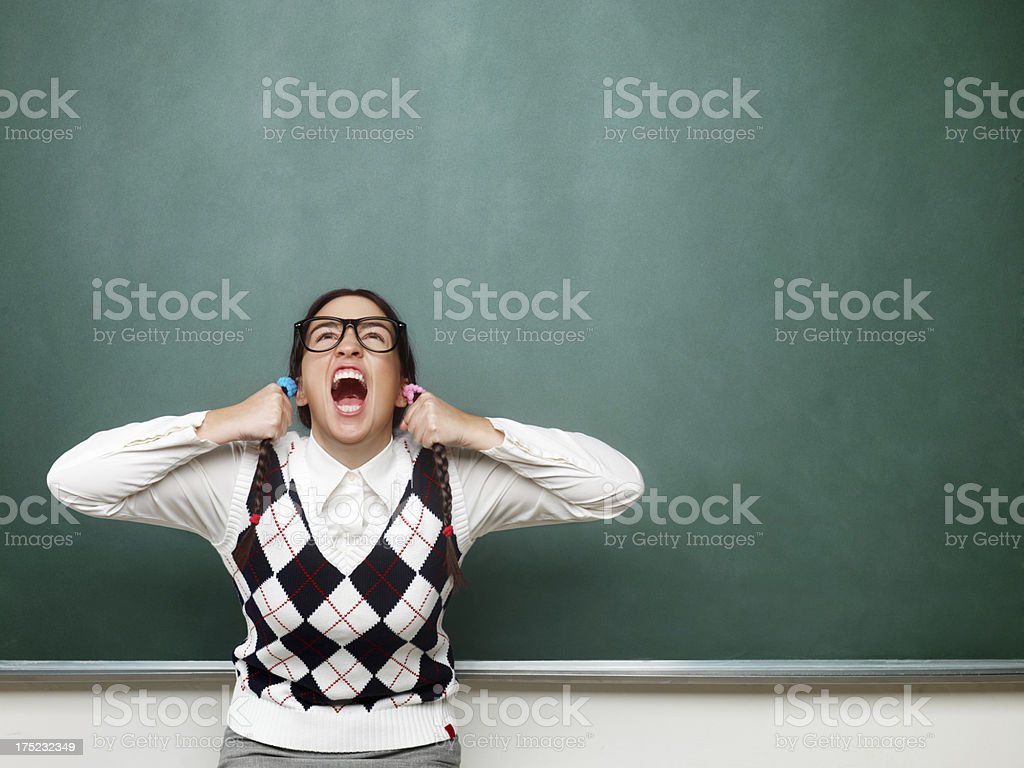 Female nerd yelling in front of the blackboard royalty-free stock photo