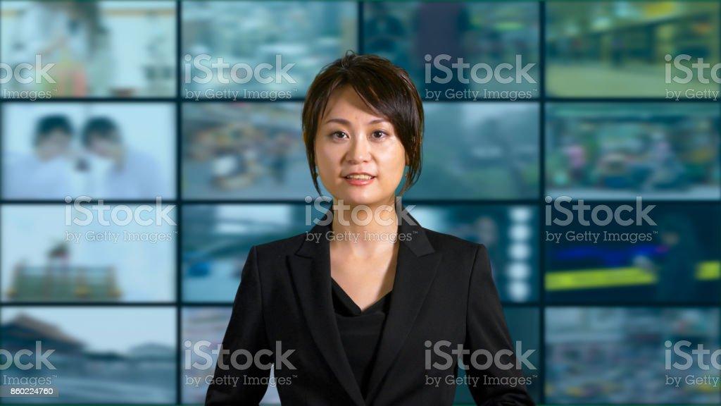 Female news anchor in studio stock photo
