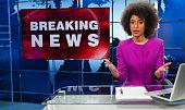 istock Female Newsreader In Studio 1220571544