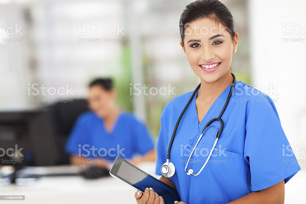Female nurse in blue uniform with tablet stock photo