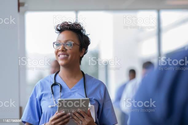 Female nurse or doctor smiles while staring out window in hospital picture id1182796886?b=1&k=6&m=1182796886&s=612x612&h=9p9w40umd2 5rx2msq vc3pfowzghkxwevlws4zfhqo=