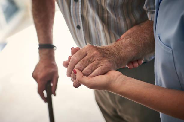 Female nurse supporting senior man to walk picture id912072074?b=1&k=6&m=912072074&s=612x612&w=0&h=yu pd7jdl2rmd6sewsc5mtvpph6lnmrhozpwgkihqo0=