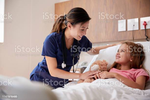 Female nurse visiting girl lying in hospital bed hugging teddy bear picture id1147976485?b=1&k=6&m=1147976485&s=612x612&h=j4 je2c2nf8bgzxhv gjhhvwbmhcdwokwek64cajtrq=