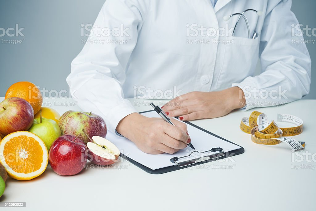 Female nutritionist at work stock photo