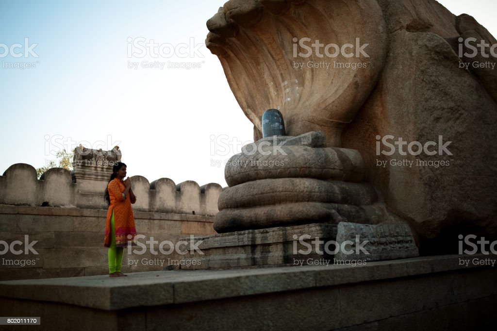 Female Offering Salutation to the Hindu Serpent God stock photo