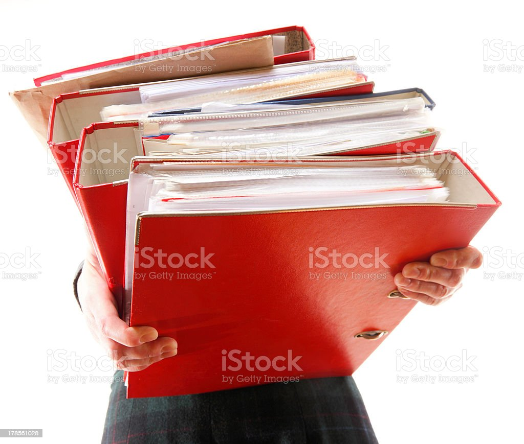 Female office worker carrying a stack of files royalty-free stock photo