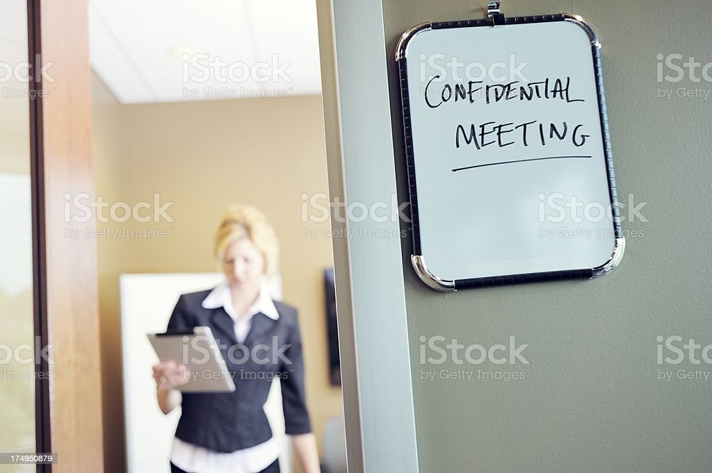 Female Office Worker in Meeting stock photo