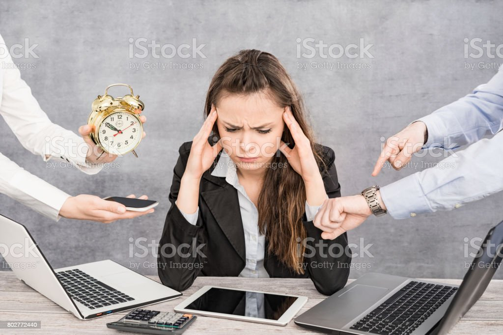 Female office worker is tired of work and exhausted. stock photo