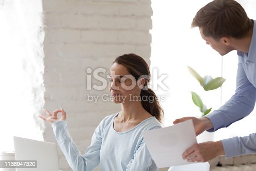 916520034istockphoto Female office worker keep calm when angry boss shout 1138947320