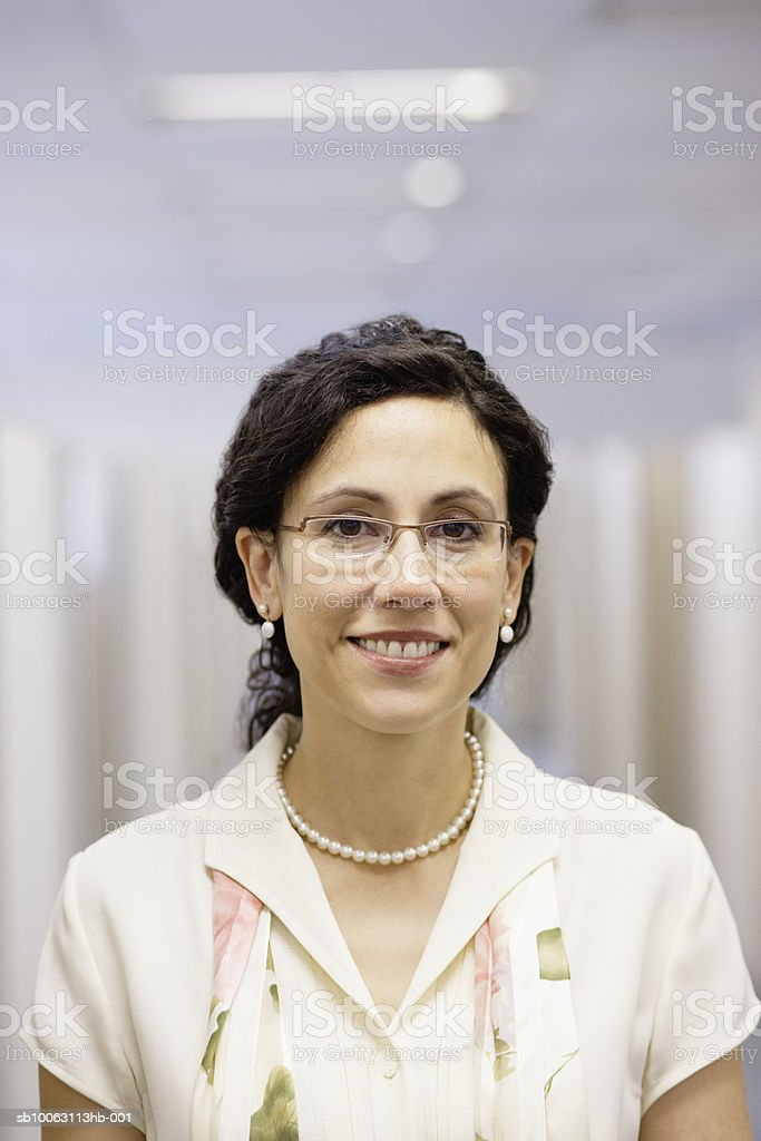 Female office worker smiling, close-up, portrait 免版稅 stock photo