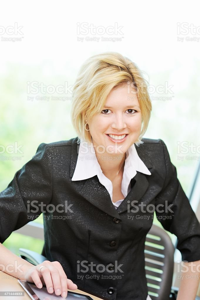 Female Office Worker Using Tablet Computer royalty-free stock photo