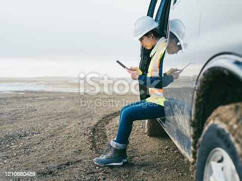 female oil worker working at oil field, Saskatchewan, Canada.