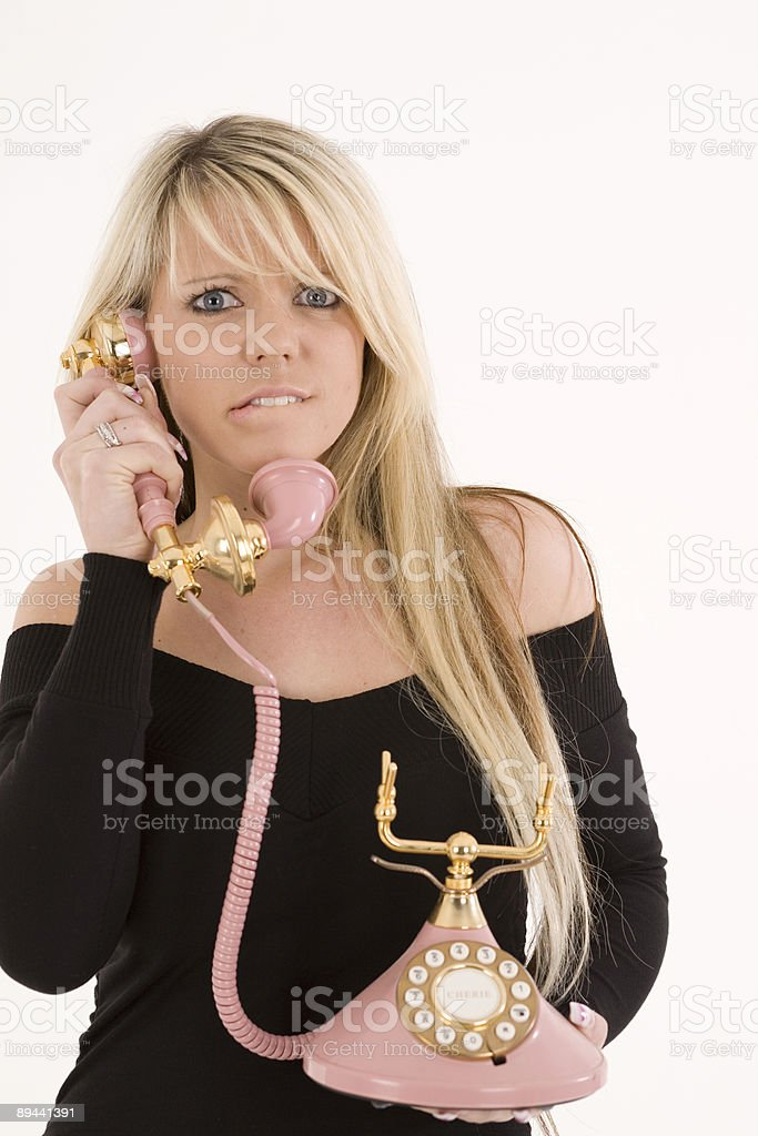 Female on a pink telephone royalty free stockfoto