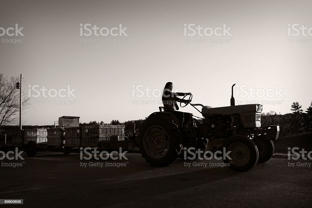 Female on farm equipment royalty-free stock photo