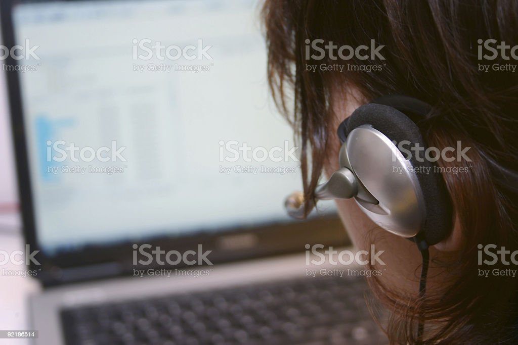 female operater with laptop stock photo
