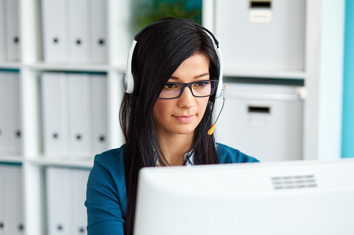 Female Operator With Headset Stock Photo - Download Image Now