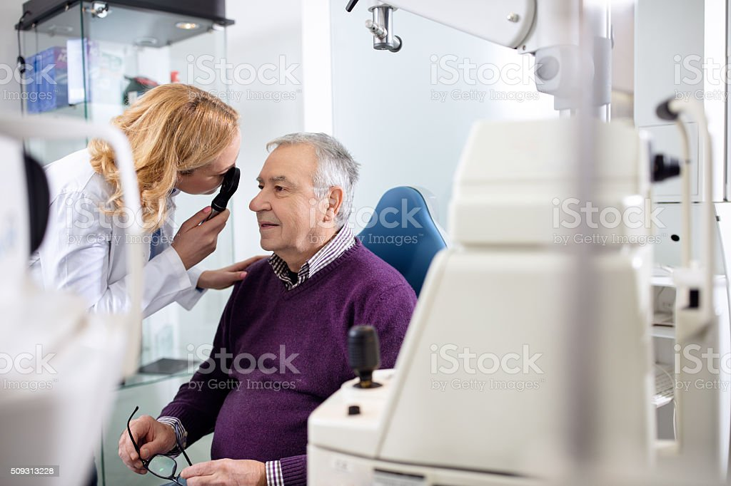 Female ophthalmologist determines diopter stock photo