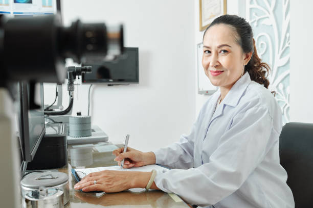 Female optometrist at office stock photo