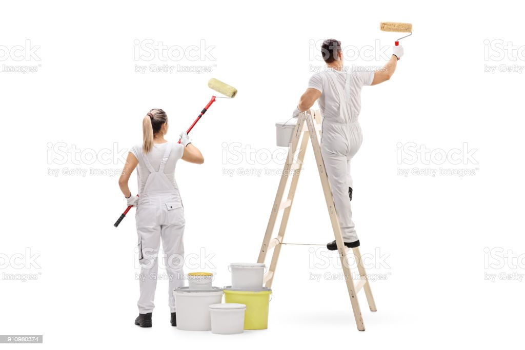 Female painter and a male painter climbed up a ladder painting stock photo