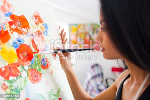 istock Female painter drawing in her studio 843290260
