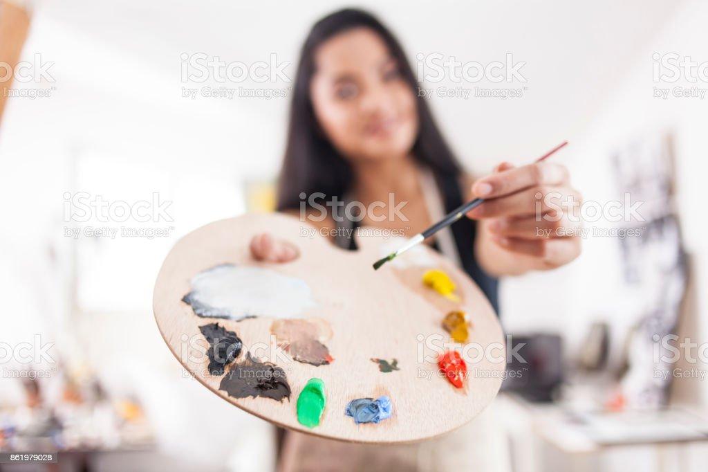Female painter holding palette stock photo