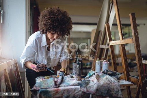 istock Female painter 890109808