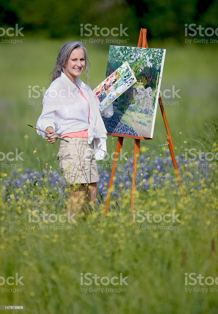 Female Painting in Field of Bluebonnets royalty-free stock photo