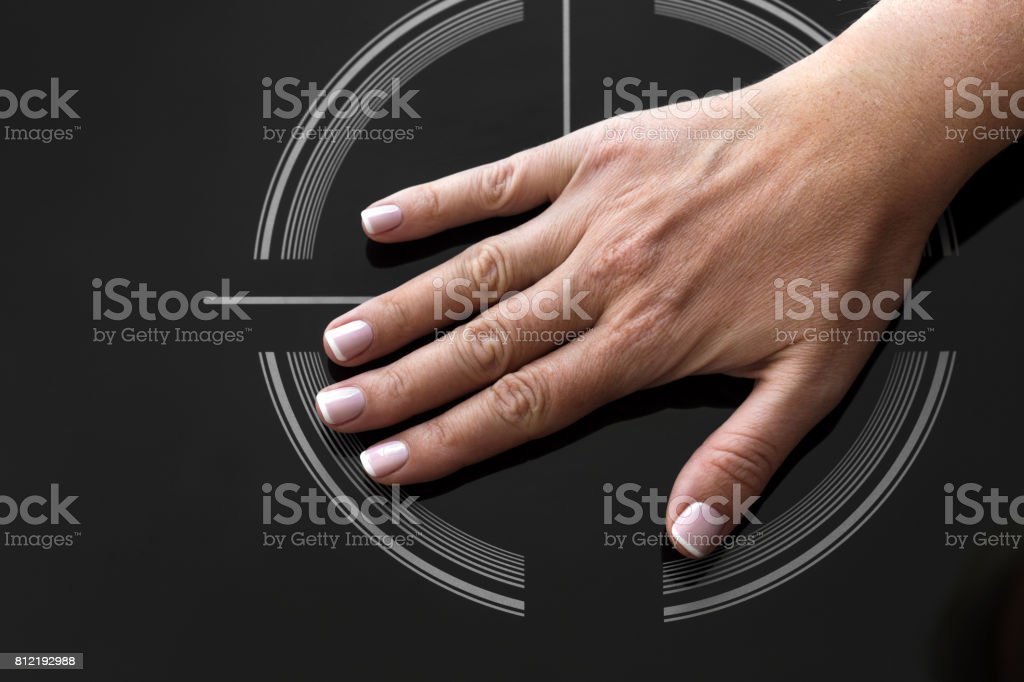Female palm hand on on Induction stove stock photo