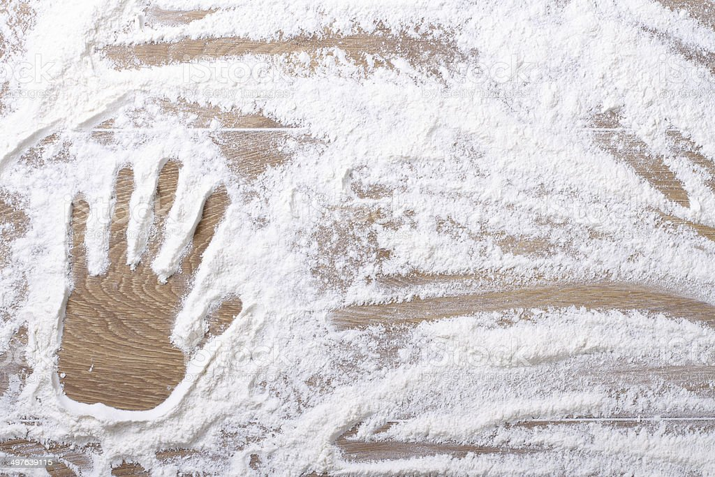 female palm print on flour scattered royalty-free stock photo