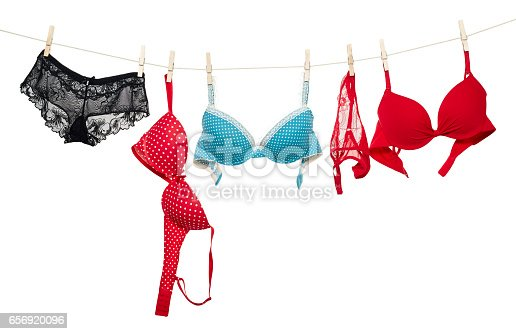 istock Female panties and bra hanging on rope 656920096
