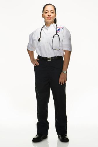 Female Paramedic on white background, portrait