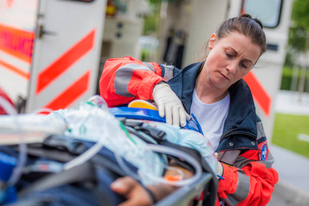Female paramedic with patient stock photo