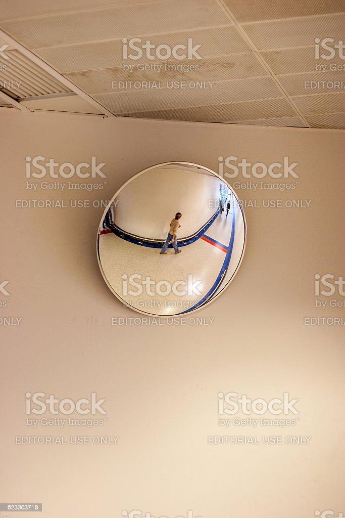 Female passenger reflection in convex mirror stock photo