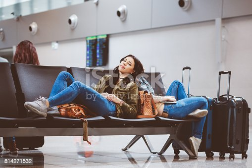 istock Female passengers at the airport lounge tired waiting for flight 814271532