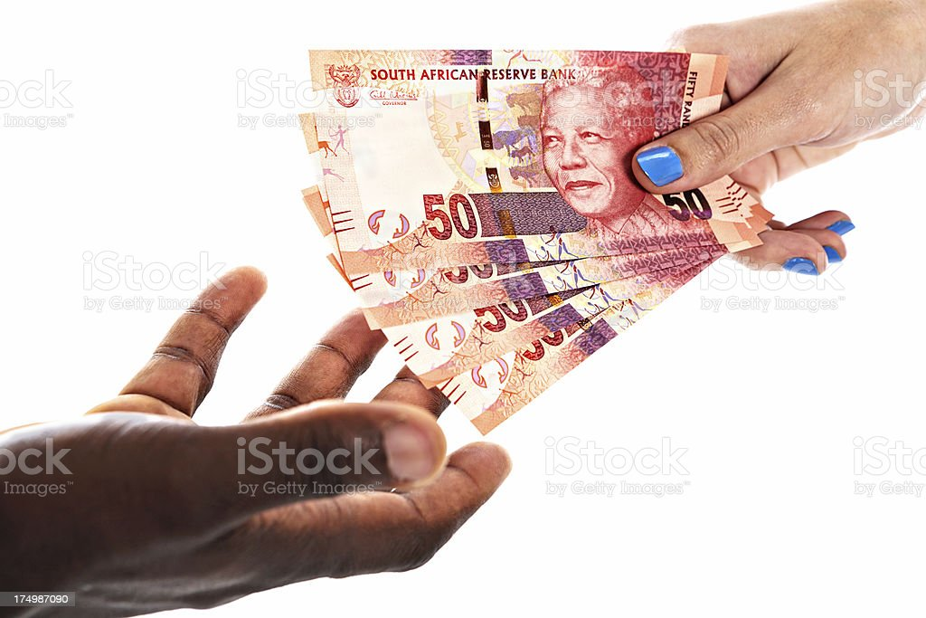 Female passing New South African banknotes featuring Mandela to man royalty-free stock photo