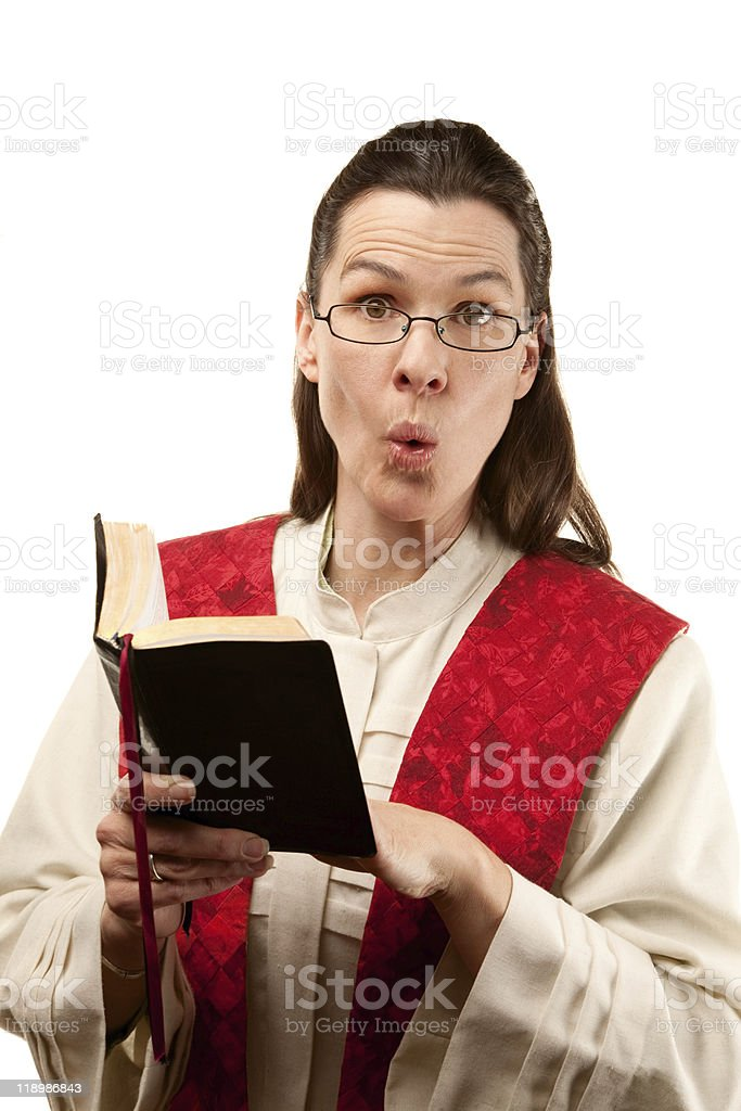 Female pastor finding something shocking in the Bible stock photo