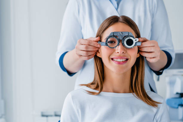 Female patient checking vision in ophthalmological clinic Medicine, Hospital, Medical Clinic, Ophtalmologist, Exam optometrist stock pictures, royalty-free photos & images