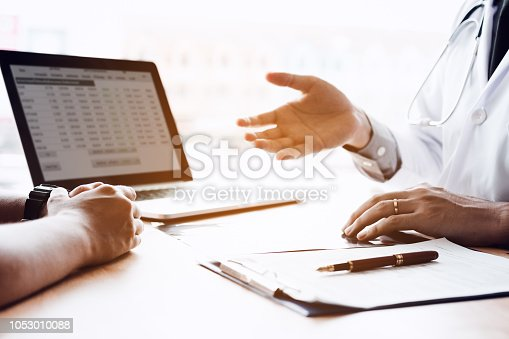1026367516 istock photo Female patient listening to doctor at desk and consulting with healthcare in hospital. 1053010088
