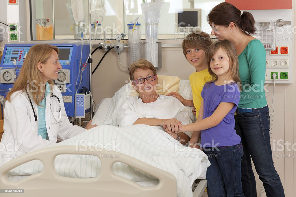 female patient very happy with family and doctor royalty-free stock photo