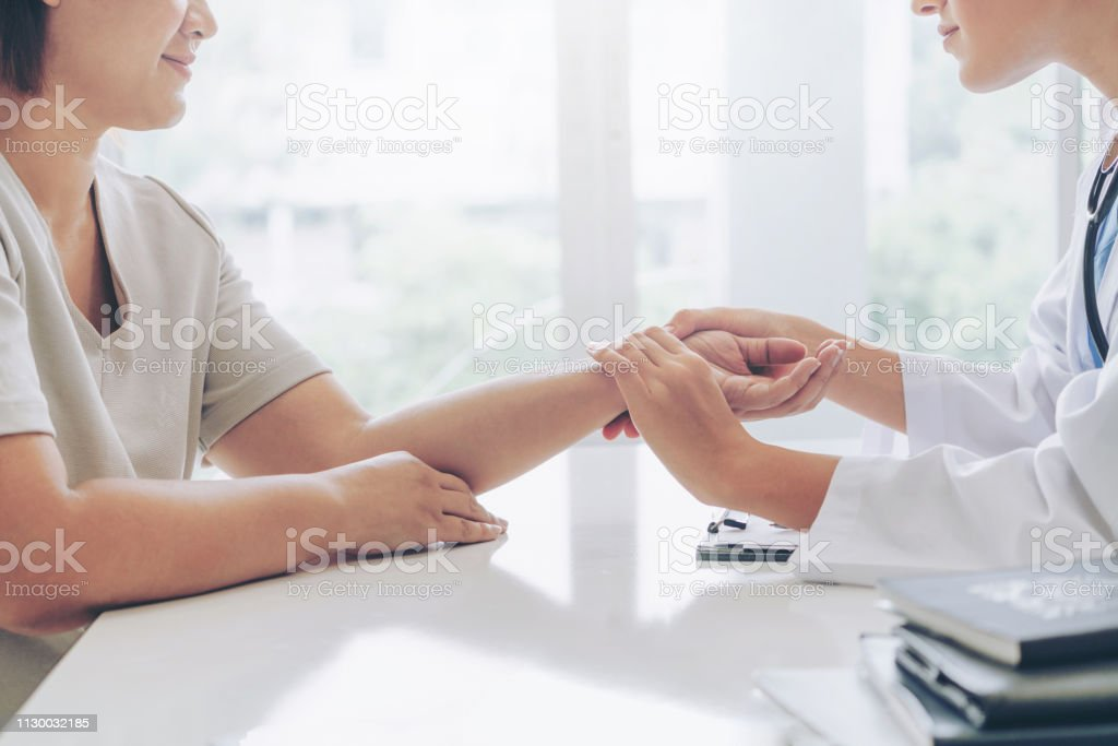 Female patient visits woman doctor or gynecologist during gynaecology check up in office at the hospital. Gynecology healthcare and medical service. stock photo
