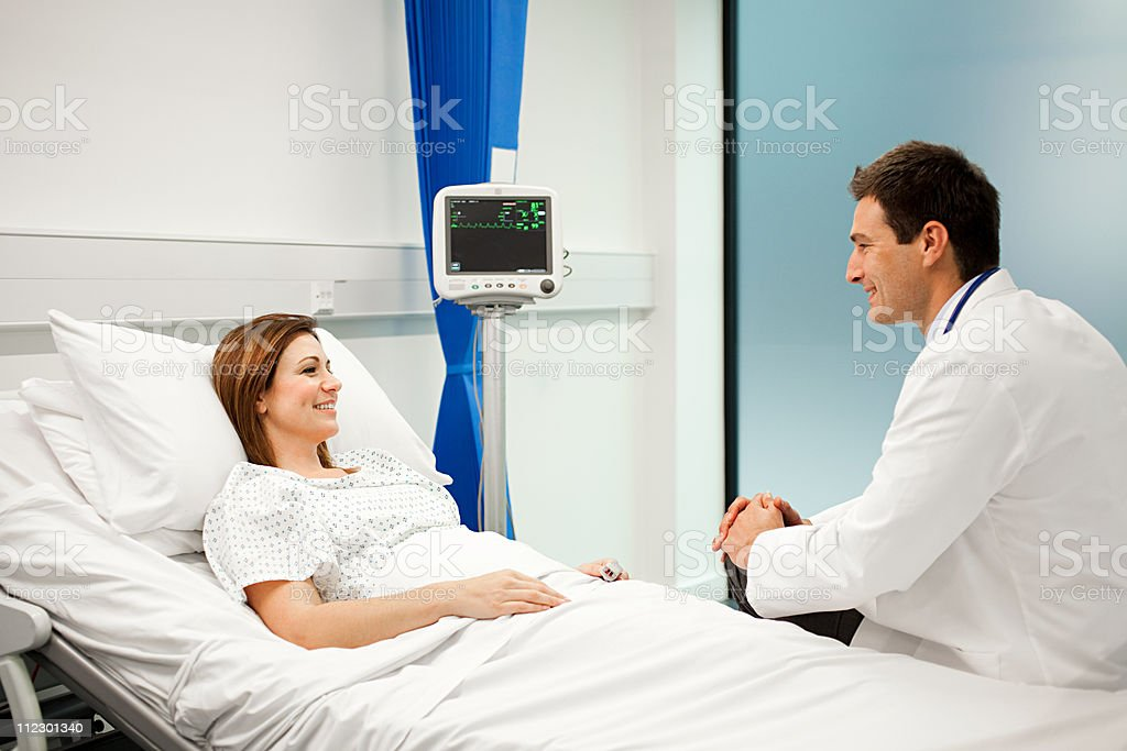 Female patient with doctor stock photo
