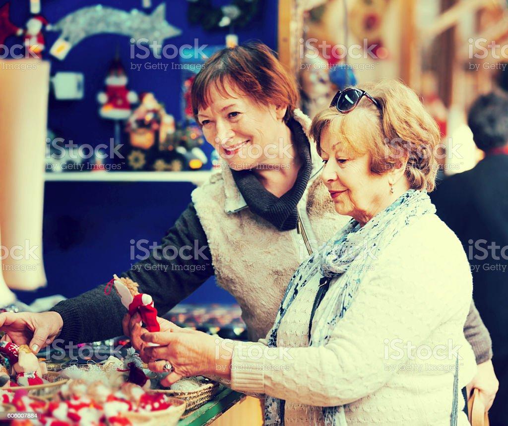Female pensioners buying X-mas decorations stock photo